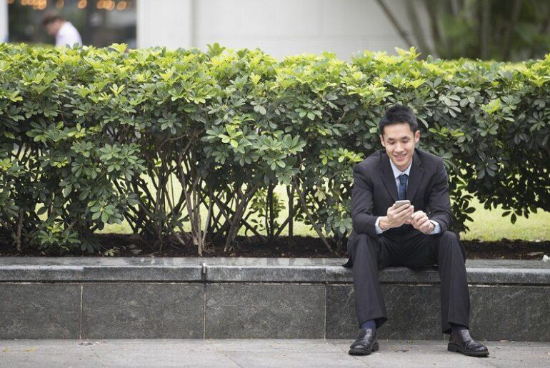 Chinese Business Man Using His Mobile Phone.